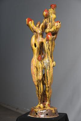 Tan figure with red buds; 2010